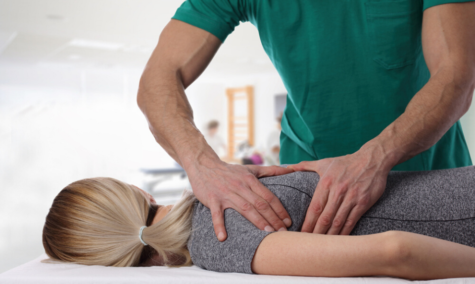 local chiropractor having a session with a patient