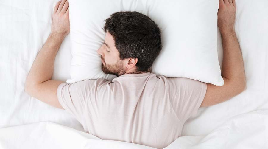 Sleeping on your stomach may give you neck pain in the morning.